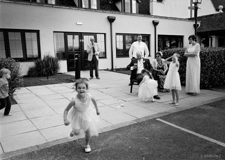 film photography, kids having fun at a wedding