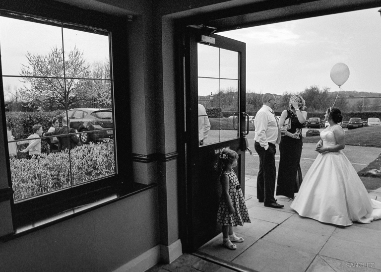 Bride and groom chatting with family and friends. Film wedding.